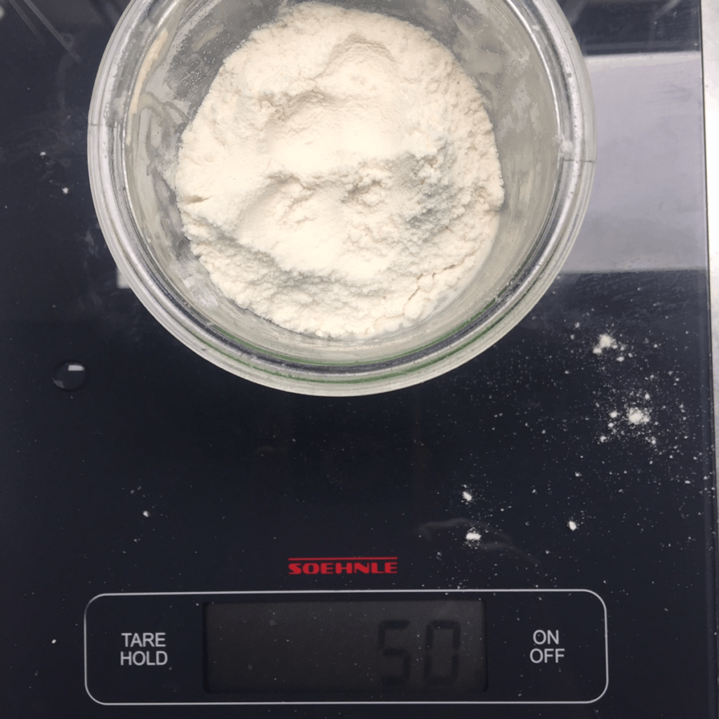 Starter with fresh flour on a digital scale