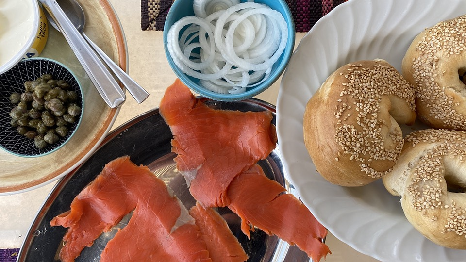 Lunchtime bagels with smoked salmon, onions, capers and cream cheese