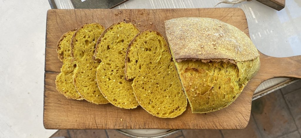 Loaf and slices of turmeric bread