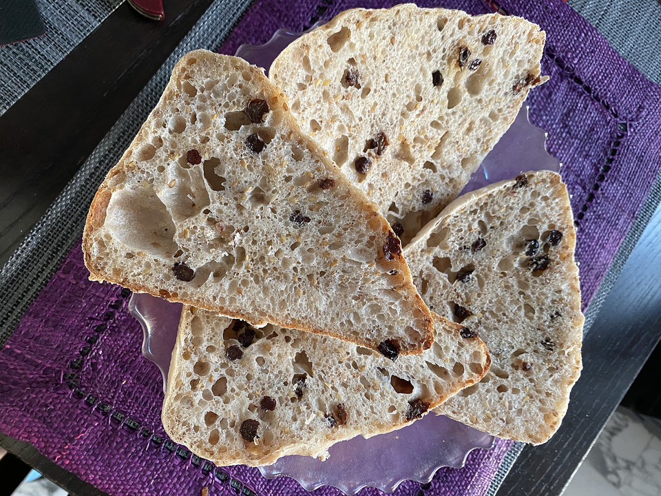 Little loaves sliced to show open crumb structure.